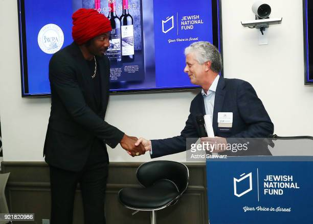 Basketball player Amar'e Stoudemire and Sid Banon pose for photos during 'Stoudemire Wines' launch reception with the Jewish National Fund at Ronald...