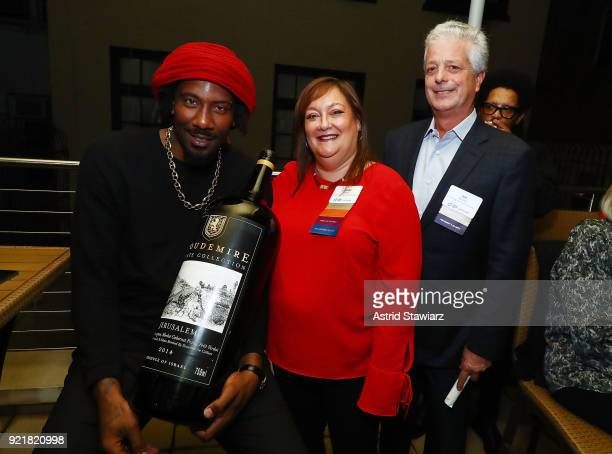 Basketball player Amar'e Stoudemire Debby Riegel and Sid Banon pose for photos during 'Stoudemire Wines' launch reception with the Jewish National...