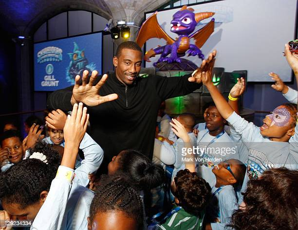 Basketball Player Amar'e Stoudemire poses with members from the Boys and Girls Club at Skylanders Spyro's Adventure Launch Event hosted by Amar'e...