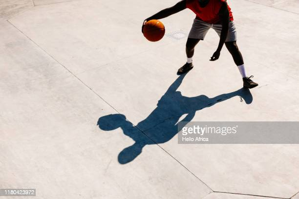a basketball player and his shadow - shadow stock pictures, royalty-free photos & images