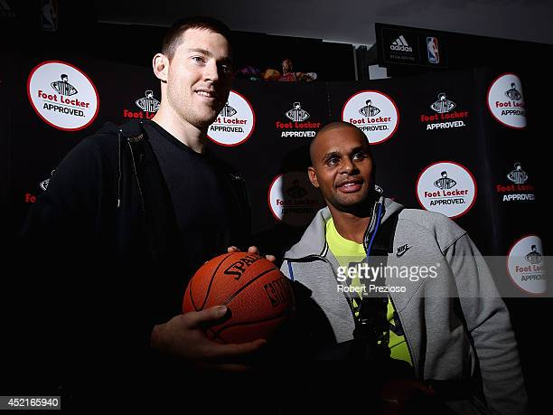 Basketball player Aron Baynes and Australian and San Antonio Spurs NBA basketball player Patty Mills pose for photos during a Footlocker in store...