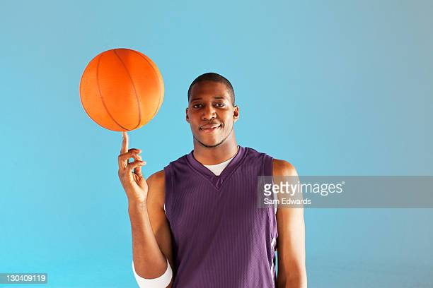 basketball player balancing ball on one finger - sportsperson stock pictures, royalty-free photos & images
