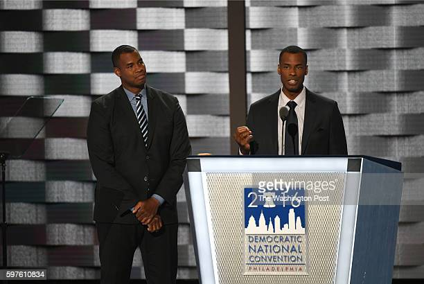 Basketball player Barron Collins introduces his twin brother Jason Collins, the first openly gay NBA player, during the first day of the Democratic...