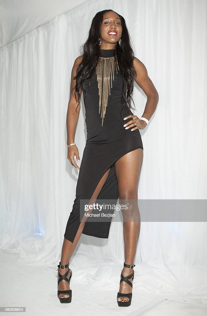 Basketball Player Candice Wiggins attends 1st Annual Runway Wonderland Children's Benefit By Trina's Kids Foundation at Hubble Studio on December 10, 2014 in Los Angeles, California.
