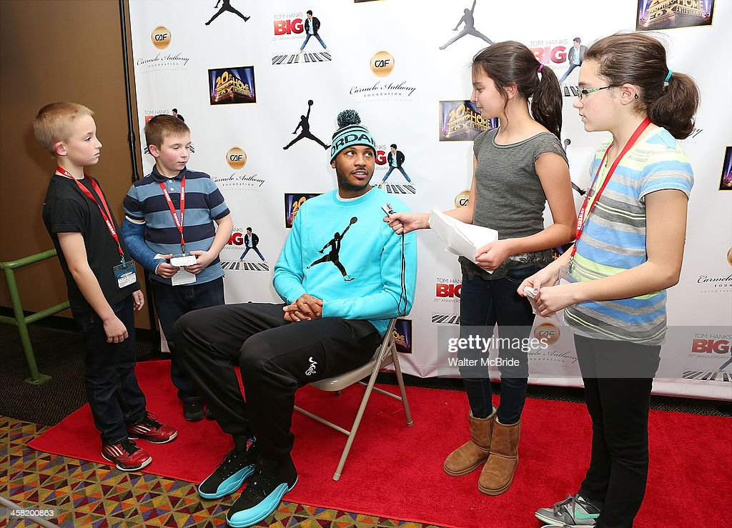 NBA basketball player Carmelo Anthony with young journalists attend the 'Big' 25th Anniversary Edition Blu-ray Release special screening benefiting the Carmelo Anthony Foundation at AMC Empire on December 20, 2013 in New York City.
