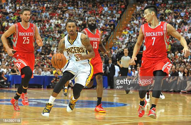 Basketball player Chandler Parsons George Hill of the Indiana Pacers James Harden and Jeremy Lin of the Houston Rockets vie for the ball during the...