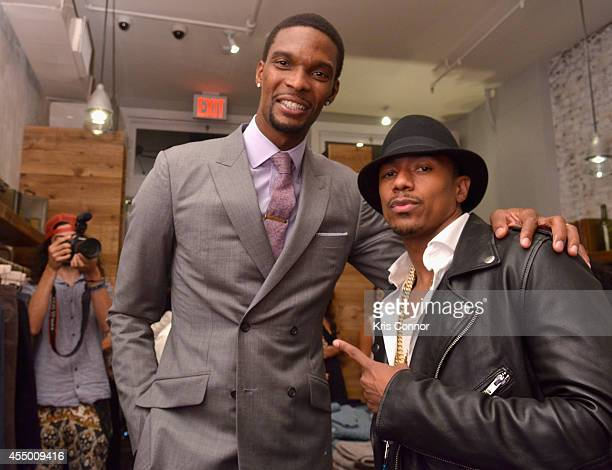 Basketball player Chris Bosh and actor Nick Cannon attend Chris Bosh and Hennessy VS Raise a Glass to Mr Nice Tie at Carson Street Clothiers on...