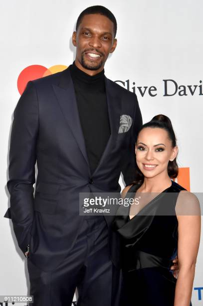 Basketball player Chris Bosh and Adrienne Williams Bosh attend the Clive Davis and Recording Academy PreGRAMMY Gala and GRAMMY Salute to Industry...