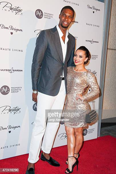 Basketball player Chris Bosh and his wife Adrienne Bosh attend Haute Living Haute 100 Dinner presented by Dom Perignon at Tamarina at Brickell World...