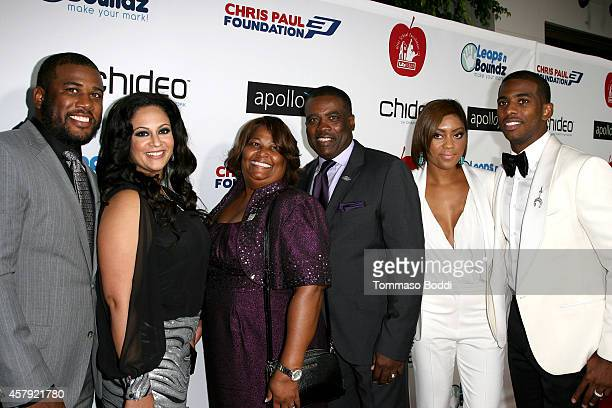 Basketball player Chris Paul , Jada Crawley and family attend the CP3 Foundation celebrity server dinner at Mastro's Steakhouse on October 26, 2014...