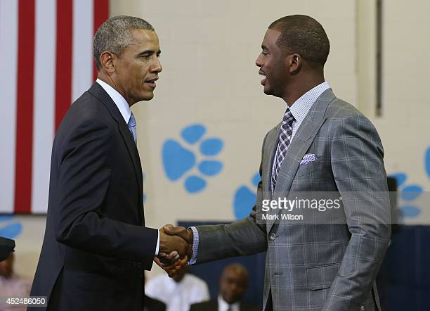 Basketball player Chris Paul of Los Angeles Clippers introduces U.S. President Barack Obama at the Walker Jones Education Campus, on July 21, 2014 in...
