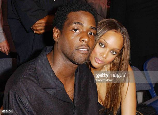 Basketball player Chris Webber and his girlfriend,model Tyra Banks, attend the WBC/IBF Heavyweight Championship bout between Lennox Lewis and Mike...