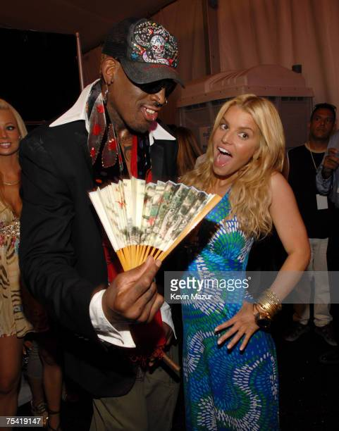 Basketball Player Dennis Rodman and Musician/Designer Jessica Simpson backstage before her Swimwear Show at the Raleigh Hotel on July 14, 2007 in...