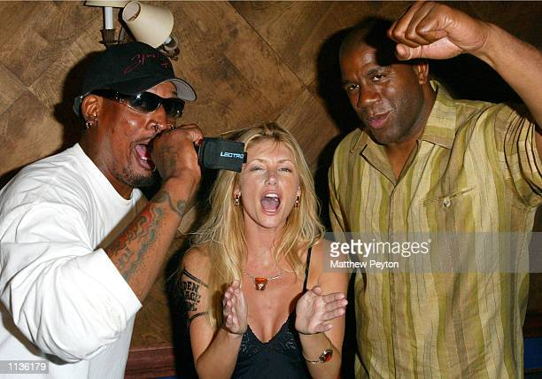 Basketball player Dennis Rodman model Brandy Roderick and basketball player Magic Johnson attend the preparty Celebrity Hoops 3 at the Tavern on July...