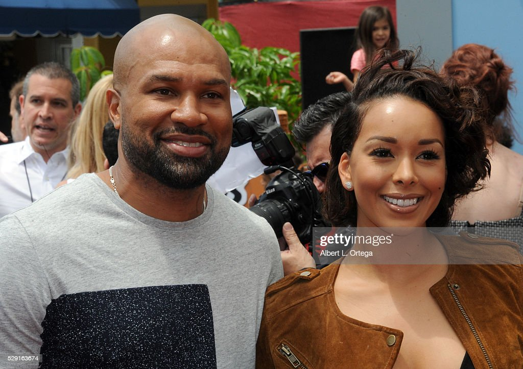 Basketball player Derek Fisher and TV personality Gloria Govan arrive for the Premiere Of Sony Pictures' 'Angry Birds' held at Regency Village Theatre on May 7, 2016 in Westwood, California.