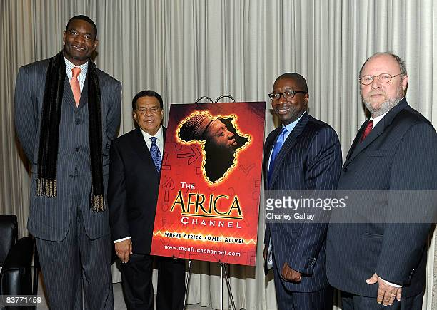 Basketball player Dikembe Mutombo Ambassador Andrew Young The Africa Channel founder James Makawa and VP External Affairs Los Angeles Time Warner...