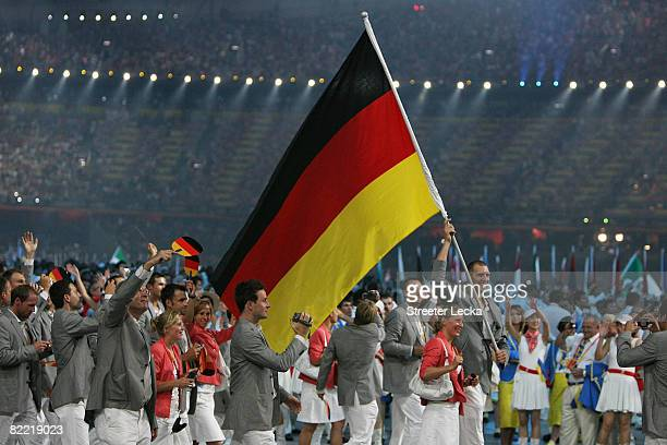 Basketball player Dirk Nowitzki of Germany carries his country's flag lading his delegation during the Opening Ceremony for the 2008 Beijing Summer...
