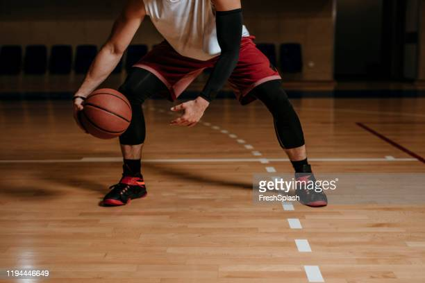 basketball player dribbling a ball - basketball sport stock pictures, royalty-free photos & images