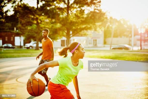 Basketball player dribbling ball during game