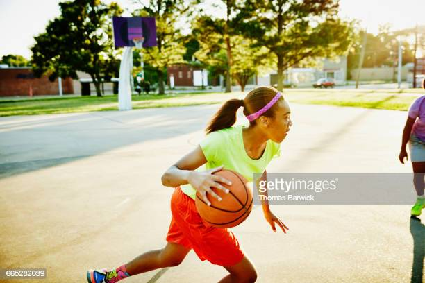 basketball player dribbling ball past defender - dribbling sports stock pictures, royalty-free photos & images