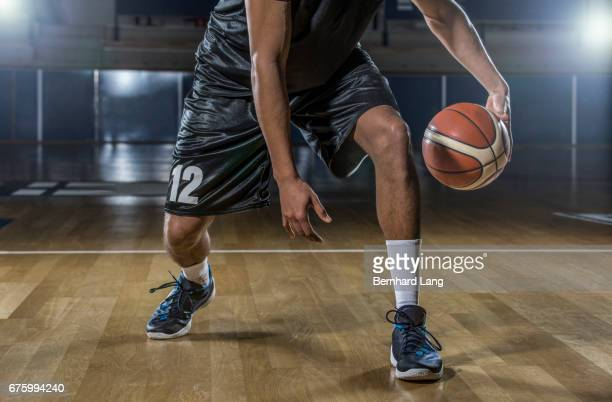 basketball player dribbling ball - dribbling stock pictures, royalty-free photos & images