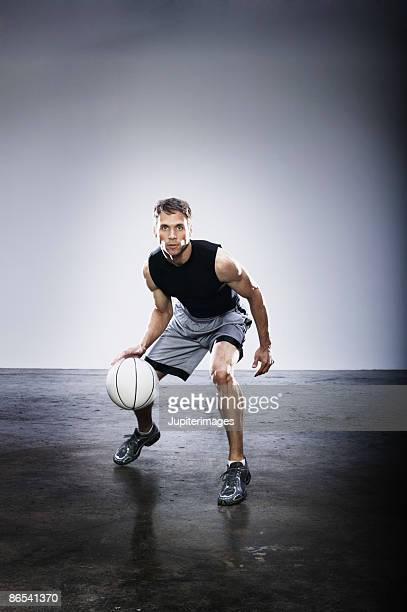 basketball player dribbling ball - bouncing stock pictures, royalty-free photos & images