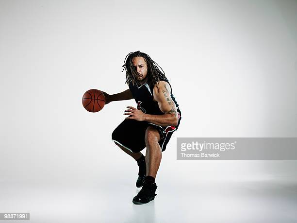 Basketball player dribbling ball