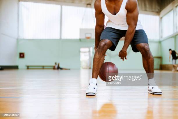 basketball player dribbling - dribbling stock pictures, royalty-free photos & images