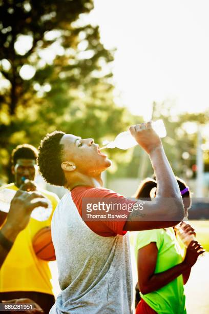 Basketball player drinking water after game