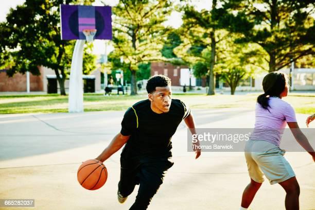 basketball player driving toward basket - ドリブル ストックフォトと画像