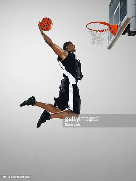 basketball player dunking ball, low angle view - shooting baskets stock pictures, royalty-free photos & images