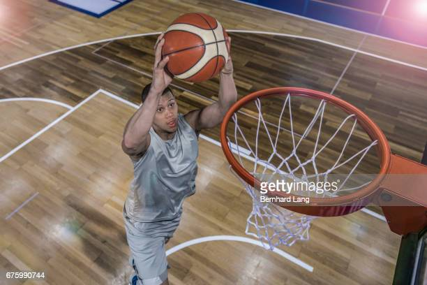 basketball player dunking ball - shooting baskets stock photos and pictures