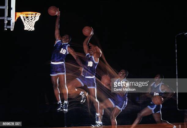 Basketball, player 'dunking' ball (multiple exposure)