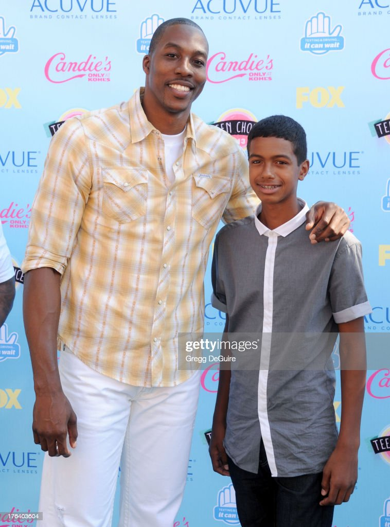 NBA basketball player Dwight Howard of the Houston Rockets arrives at the 2013 Teen Choice Awards at Gibson Amphitheatre on August 11, 2013 in Universal City, California.