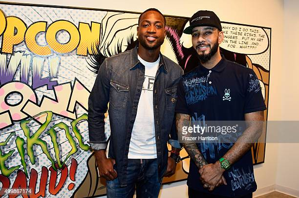 Basketball player Dwyane Wade and Swizz Beatz attends The Dean Collection X BACARDI Untameable House Party on December 3 2015 in Miami Florida