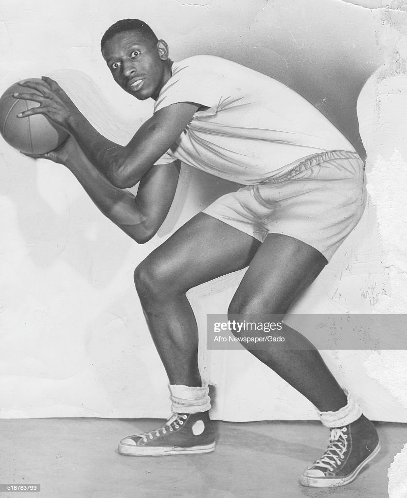 Basketball player Earl Lloyd dribbling a basketball, Virginia, 1966.