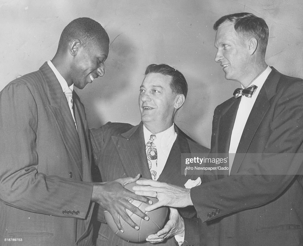 Basketball player Earl Lloyd, Jim Magner and Horace Kinley, October 20, 1950.