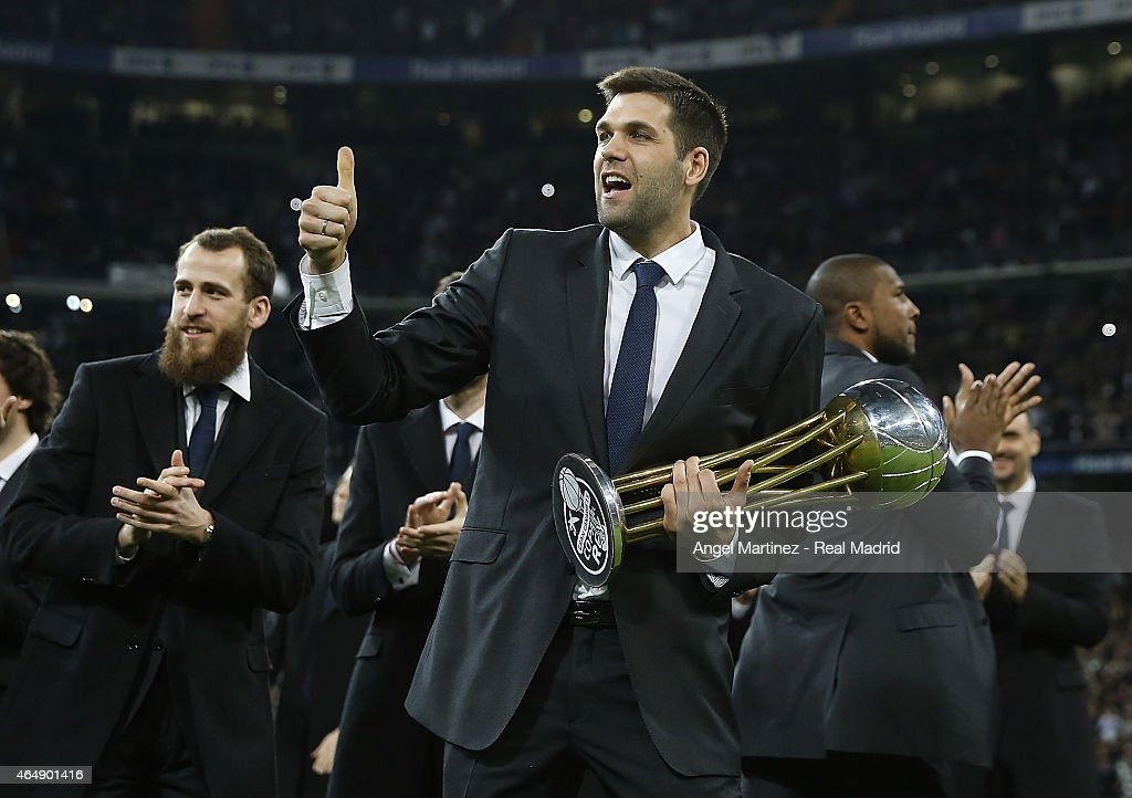 Basketball player Felipe Reyes of Real Madrid holds the recently won Copa del Rey trophy before the La Liga match between Real Madrid CF and Villarreal CF at Estadio Santiago Bernabeu on March 1, 2015 in Madrid, Spain.