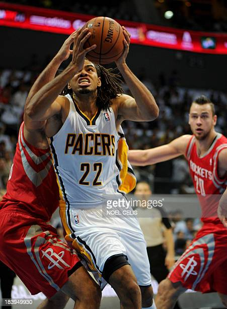 US basketball player for the Indiana Pacers Chris Copeland dunks the ball to the basket as Houston Rockets Terrence Jones attempts to block during...