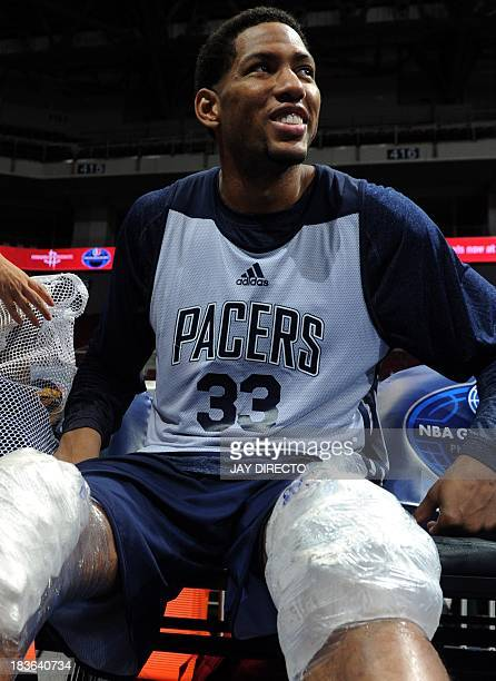 US basketball player for the Indiana Pacers Danny Granger is pictured with ice packs on his knees during a media availability at the Cuneta Dome in...