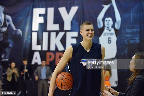 NBA basketball player for the New York Knicks Kristaps Porzingis celebrates Delta Air Lines Fly Like a Pro campaign with a HORSE competition at...