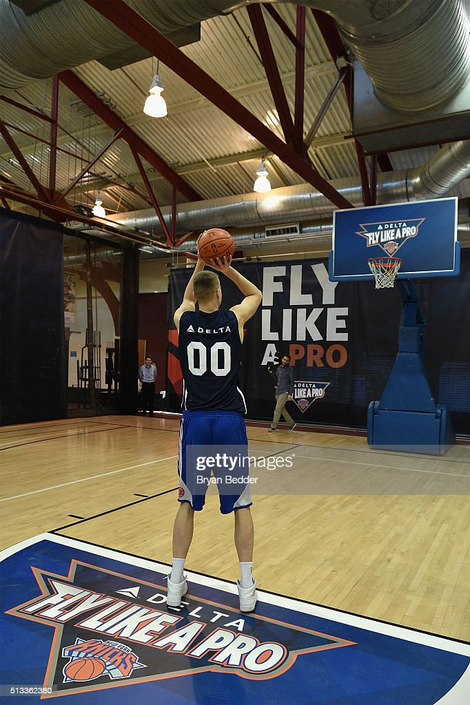 NBA basketball player for the New York Knicks, Kristaps Porzingis celebrates Delta Air Lines Fly Like a Pro campaign with a H-O-R-S-E competition at Chelsea Piers in New York City on March 2, 2016.