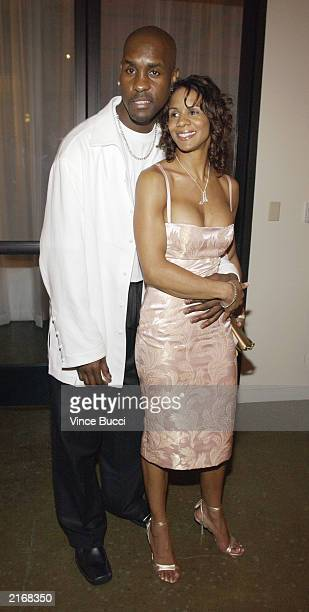 Basketball player Gary Payton and his wife pose at the 2003 ESPY Awards afterparty at The Highlands Restaurant July 16 2003 in Hollywood California