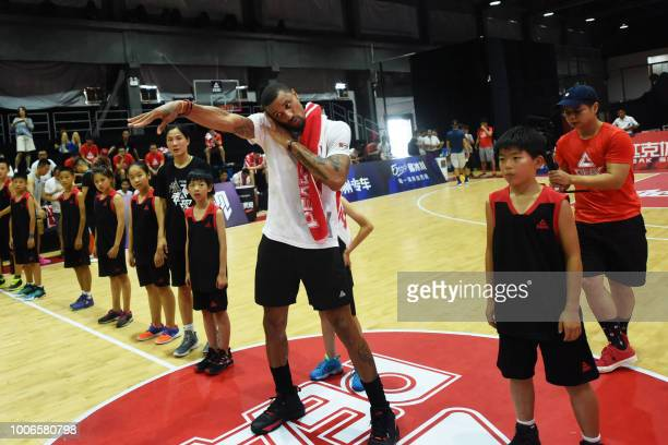 US basketball player George Hill gestures during a training session at a basketball camp in Hangzhou in China's eastern Zhejiang province on July 28...