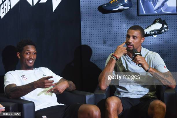 US basketball player George Hill speaks as he attends a promotional event with compatriot and fellow basketball player Louis Williams in Hangzhou in...