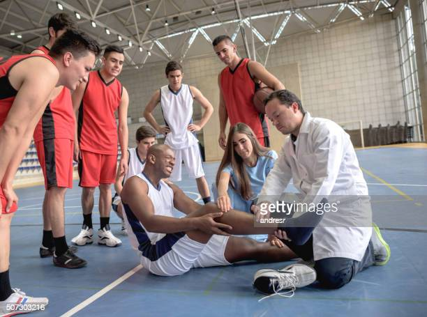basketball player getting an injury - sports medicine stock pictures, royalty-free photos & images