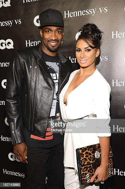Basketball player Gilbert Arenas and Laura Govan attend the GQ October Cover Party With Chris Paul with Hennessy at Sayer's Club on September 24 2012...