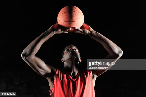 Basketball player gripping the ball