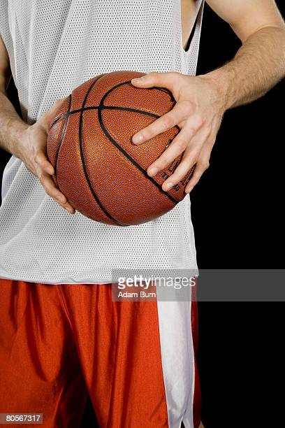 A basketball player holding a basketball