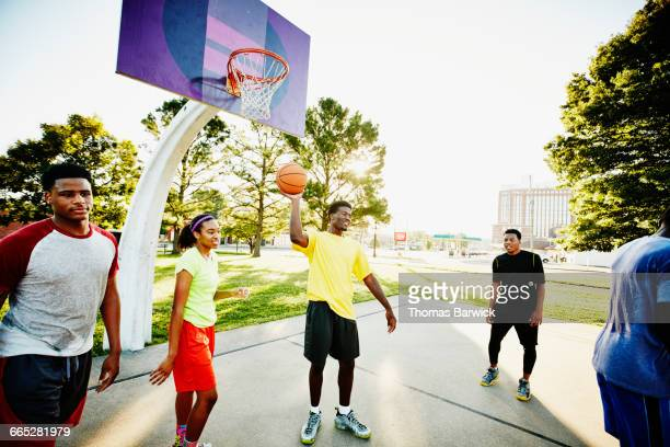 Basketball player holding ball during pickup game